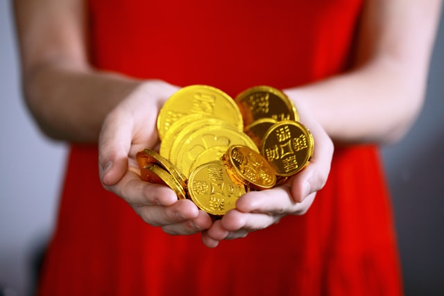A girl with gold coins in hand